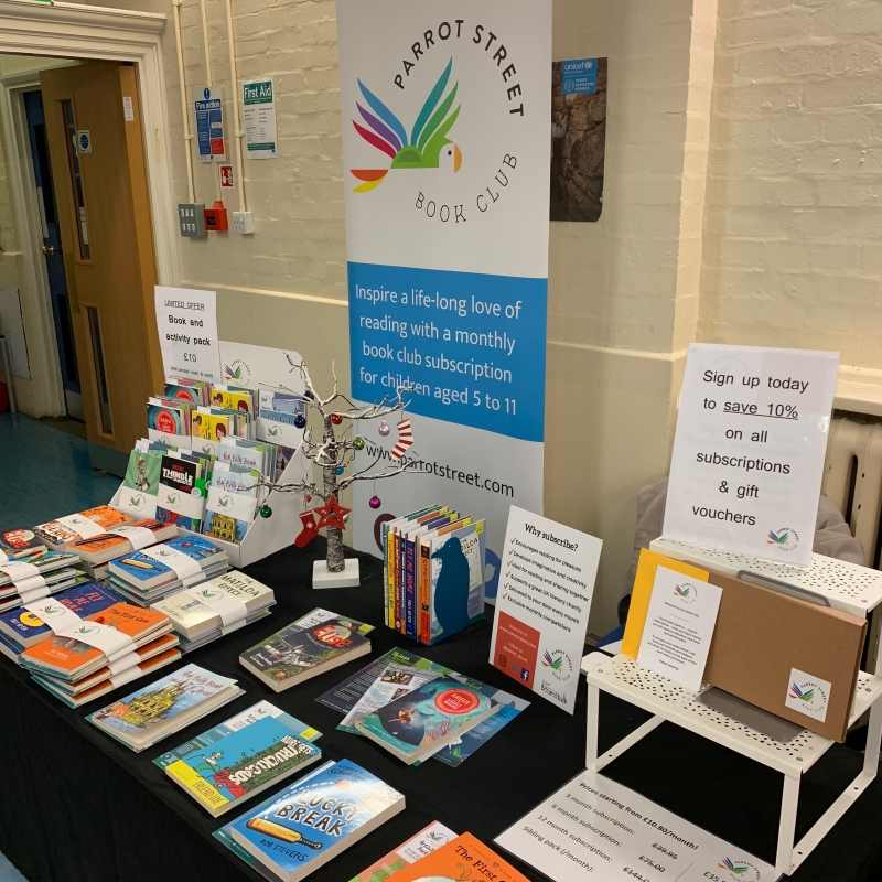 Parrot Street Book Club set up at a school Christmas shopping event