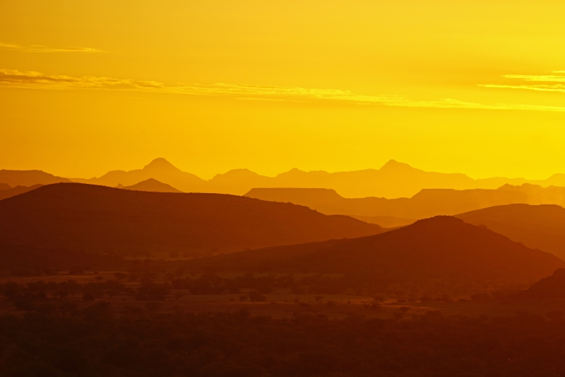 Bright yellow sunset across African landscape