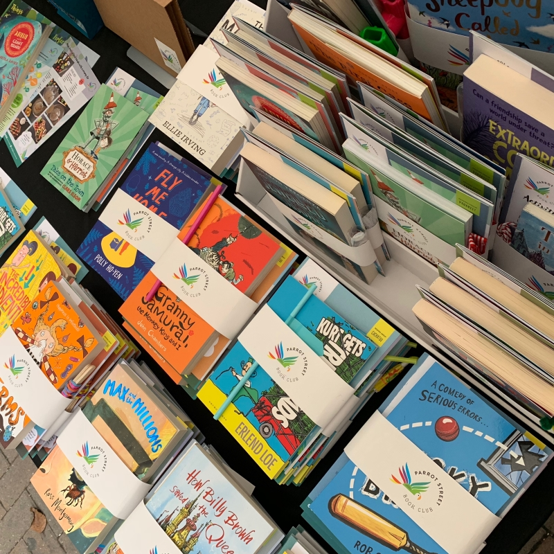 Parrot Street Book Club books and activity packs laid out