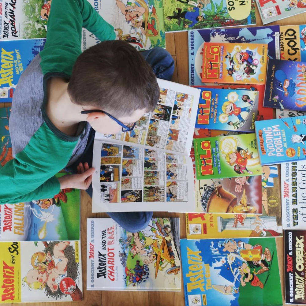 Boy reading graphic novels