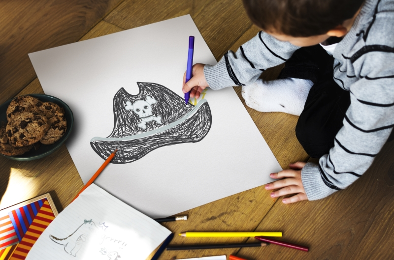 Child drawing pirate hat