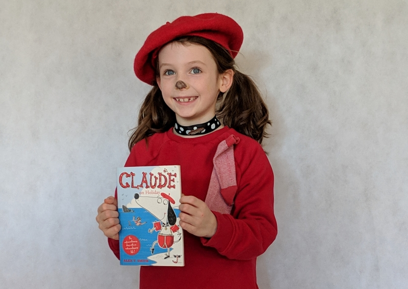 Child dressed as Claude