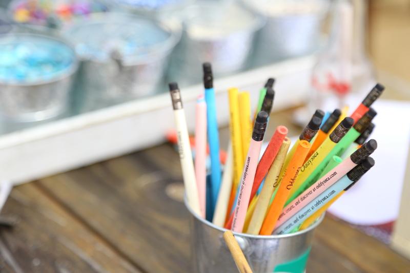 Coloured pencils in a metal pot