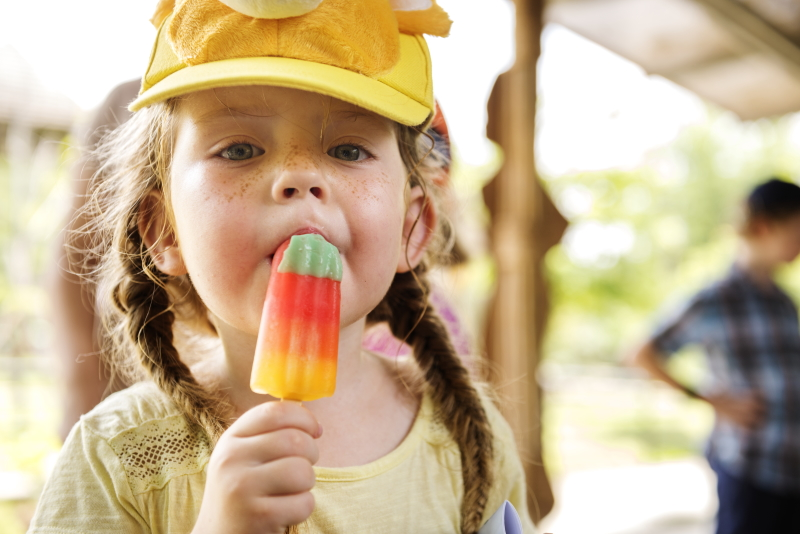Young girl eating an ice lolly