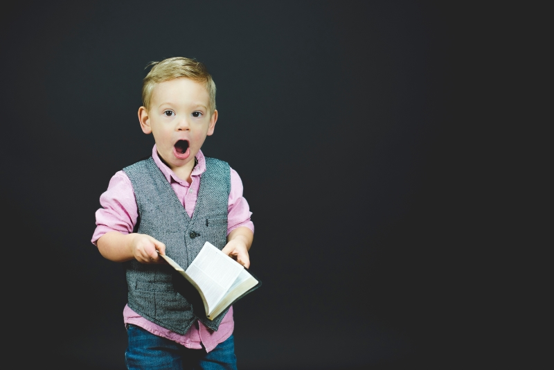 Happy child holding a book