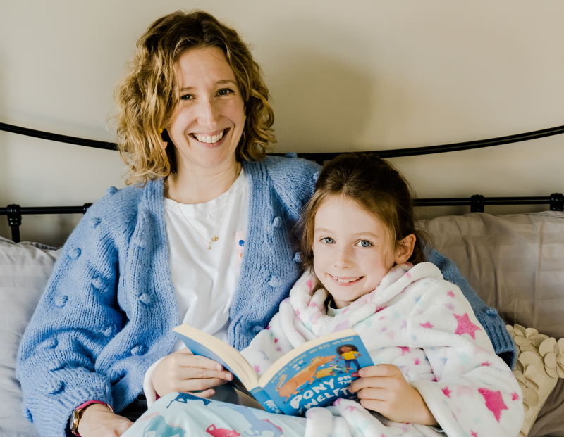 Mother and daughter reading a bedtime story