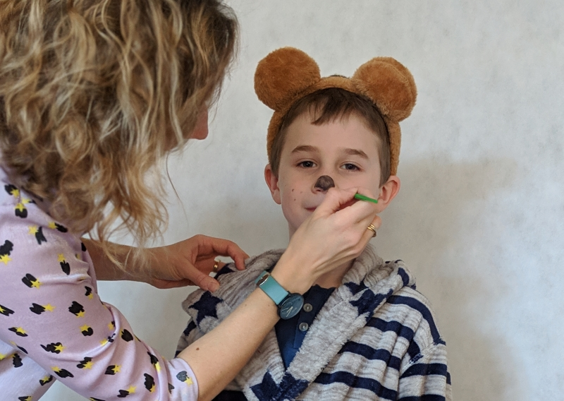 Child having face painted to be Mr Bear from Peace at Last